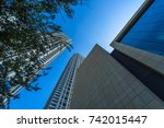 low angle view of skyscrapers... | Shutterstock . vector #742015447