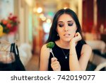 funny woman eating broccoli at... | Shutterstock . vector #742019077
