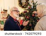 senior couple decorating... | Shutterstock . vector #742079293