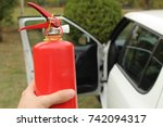 extinguisher in human hand. | Shutterstock . vector #742094317