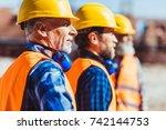 builders in reflective vests... | Shutterstock . vector #742144753