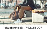fashion man with bag sits on a... | Shutterstock . vector #742155007