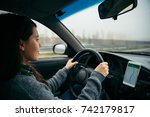 Woman Driving Car By Highway I...