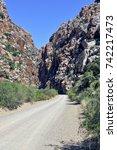 dirt road leading to between... | Shutterstock . vector #742217473