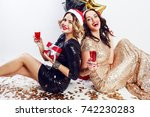 two happy   girls   in  in red... | Shutterstock . vector #742230283