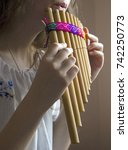 Small photo of Girl playing pan flute
