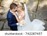 walk the newlyweds. the bride... | Shutterstock . vector #742287457