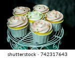 colorful cupcakes on cakestand... | Shutterstock . vector #742317643