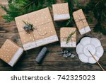 christmas presents on brown... | Shutterstock . vector #742325023
