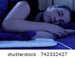 woman sleeping peacefully on an ... | Shutterstock . vector #742332427