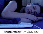 woman sleeping peacefully on an ... | Shutterstock . vector #742332427