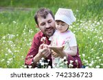 dad shows the daughters a big... | Shutterstock . vector #742336723