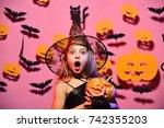 little witch wearing black hat. ... | Shutterstock . vector #742355203