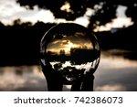 Glass Ball Display Sunset Sky...