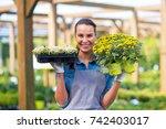 smiling employee in garden... | Shutterstock . vector #742403017