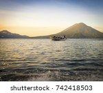 tourist boat on lake atitlan... | Shutterstock . vector #742418503