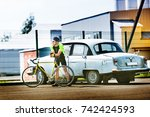 a cyclist is standing in the... | Shutterstock . vector #742424593
