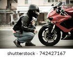 a guy a motorcyclist in a... | Shutterstock . vector #742427167