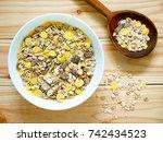 a bowl of muesli breakfast with ... | Shutterstock . vector #742434523