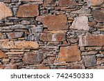 wall background built from heap ... | Shutterstock . vector #742450333