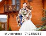 newlyweds on a winter walk. the ... | Shutterstock . vector #742550353