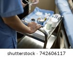 nurse preparing medical... | Shutterstock . vector #742606117