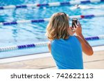 mother taking pictures with her ... | Shutterstock . vector #742622113