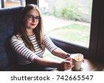 woman wearing glasses is...   Shutterstock . vector #742665547