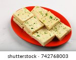 plate of delicious indian sweet ... | Shutterstock . vector #742768003
