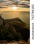 Small photo of Sunset at an Austrian mountain top with afterglow and fog between the surrounding hills