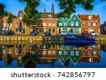 river houses reflection in... | Shutterstock . vector #742856797
