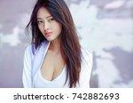 portrait of attractive sporty...   Shutterstock . vector #742882693