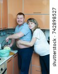 the husband is preparing a... | Shutterstock . vector #742898527