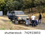 Small photo of CABRIERES, FRANCE - OCTOBER 14: Repairing a mechanical problem on an off-road car on a trial run, october 14, 2017.