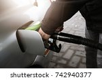 man filling up fuel in the car