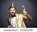 man with birthday hat toasting  | Shutterstock . vector #742962787
