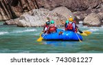 young persons rafting on the... | Shutterstock . vector #743081227
