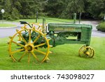 Small photo of GUATEMALA , SAN JOSE PINULA – OCTOBER 21, 2017. Old John Deere tractor in garden with rusty grass. Editorial.