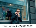 man in the jacket on the street ... | Shutterstock . vector #743120323