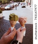 Small photo of Holding traditional italian ice cream called Gelato in the waffle cone on Rome, Italy