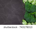 fresh broccoli on dark wooden... | Shutterstock . vector #743178313