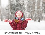 little girl playing with snow.... | Shutterstock . vector #743277967
