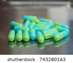 blue green capsule on counting