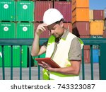 warehouse man with safety... | Shutterstock . vector #743323087