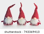 Small photo of Group christmas soft toy elves isolated on white background