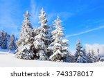 beautiful wintertime background.... | Shutterstock . vector #743378017