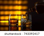 glass of whiskey with ice and... | Shutterstock . vector #743392417