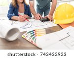 architects working on plans at... | Shutterstock . vector #743432923