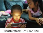 cropped view of little boy and... | Shutterstock . vector #743464723