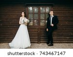 happy bride and groom near the... | Shutterstock . vector #743467147